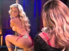 Sexy stripper in shiny red bikini dances for lesbian videos