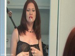 Redhead smokes in the mirror in black lingerie movies at kilotop.com