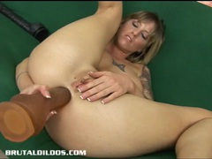 Tatted up tricia swallowing a thick dildo with her ass movies at freekilomovies.com