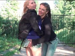 Lesbian girlfriends on a walk enjoy kissing movies