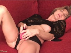 Mature model in sexy black sweater masturbates movies