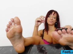 Redhead gives stirring footjobs to dildo videos