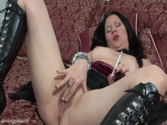 Leather boots are naughty on smoking chick movies at freekiloporn.com