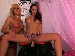 Two girls ride the dildo chair on webcam videos
