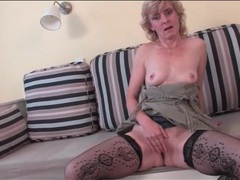 Lovely mature in fishnet stockings masturbates videos