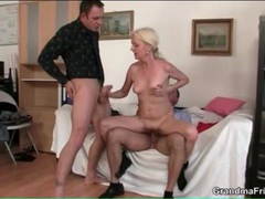 Cocks fuck slender mature blonde in threesome movies at kilopics.net