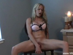 Blonde milf plays on a chair videos