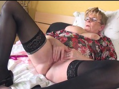 Granny in stockings and glasses masturbates videos