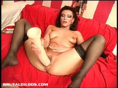 Ella's tight pussy lips grip onto a giant brutal dildo videos