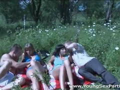 Teens on a picnic have sex in a group video videos