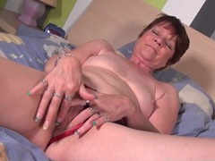 Mature model in shiny red high heels masturbates videos