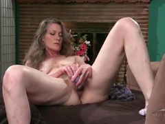 Hairy mature vibrates her pussy with a toy videos