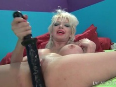Milf in whore makeup fucks her pussy with a big toy movies