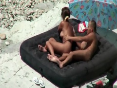 Fucking on an inflatable bed on the nude beach tubes
