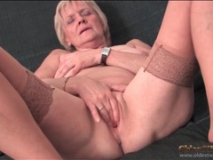Saggy granny strips to stockings and masturbates movies at lingerie-mania.com