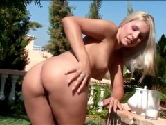Blonde pours heavy cream on her body outdoors videos