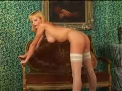Teen blonde poses beautifully in white stockings videos