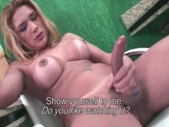 Shemale babe with great tits in striptease porn videos