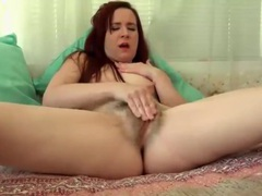 Solo redhead lustily rubs her hairy pussy videos