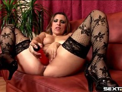 Red dildo fills soaking wet mom cunt tubes