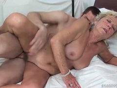 Hairy granny pussy rides a young cock videos