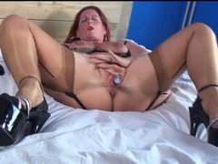 Mature redhead in sexy lingerie masturbates videos