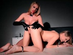 Mistress in sexy leather gloves and corset dominates videos
