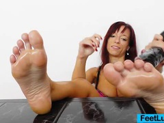 Redhead gives stirring footjobs to adult toy videos