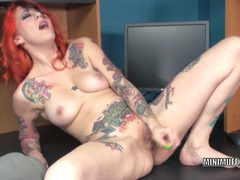 Tattooed milf scarlett storm stuffs her twat with a toy tubes