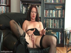 Mina looks so tasty smoking in her black stockings videos