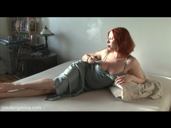 Redhead in a lovely satin dress smokes cigarette movies at kilovideos.com