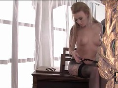 Gorgeous body on tattooed blonde in stockings movies at lingerie-mania.com