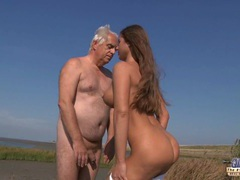 Old guy seduced and fucked by a nympho busty girl on the beach videos