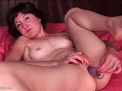 Shaved mom masturbates with a toy videos