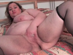 Chubby girl models her shaved pussy for us videos