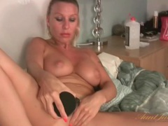 Black dildo fucks milf chick with big tits videos
