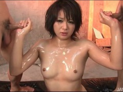 Beautiful japanese girl oiled up and sucking cock tubes at japanese.sgirls.net