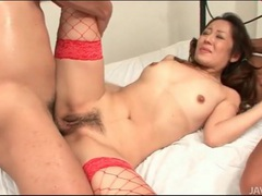 Japanese slut in red fishnets fucked in her box tubes at japanese.sgirls.net