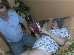 Granny masturbates as her man watches videos