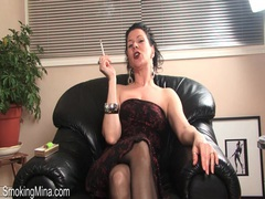 Dirty talking milf strips and smokes cigarette videos