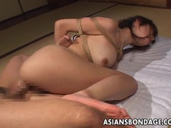 Tempting asian babe in bondage gets screwed hard tubes at sgirls.net
