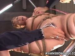 Delicious asian gal has her pussy stimulated during bondage movies at find-best-videos.com