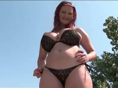Curvy redhead in sexy black bikini outdoors videos