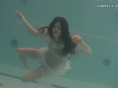 Young brunette swims in sheer white clothes videos