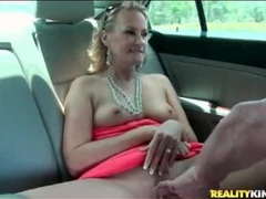Blonde milf shows tits and cunt in the car movies at sgirls.net