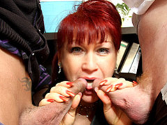 Mature redhead sucks in office videos