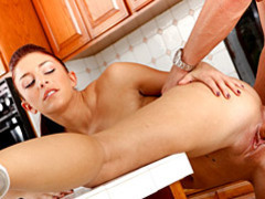 Redhead laid over a kitchen counter movies