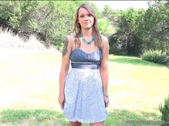 Girl with tattooed arm models dress outdoors clip