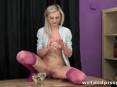 Blonde pees in wine glasses and pours it videos