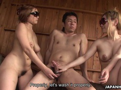 Two tender japanese babes suck on a big cock videos